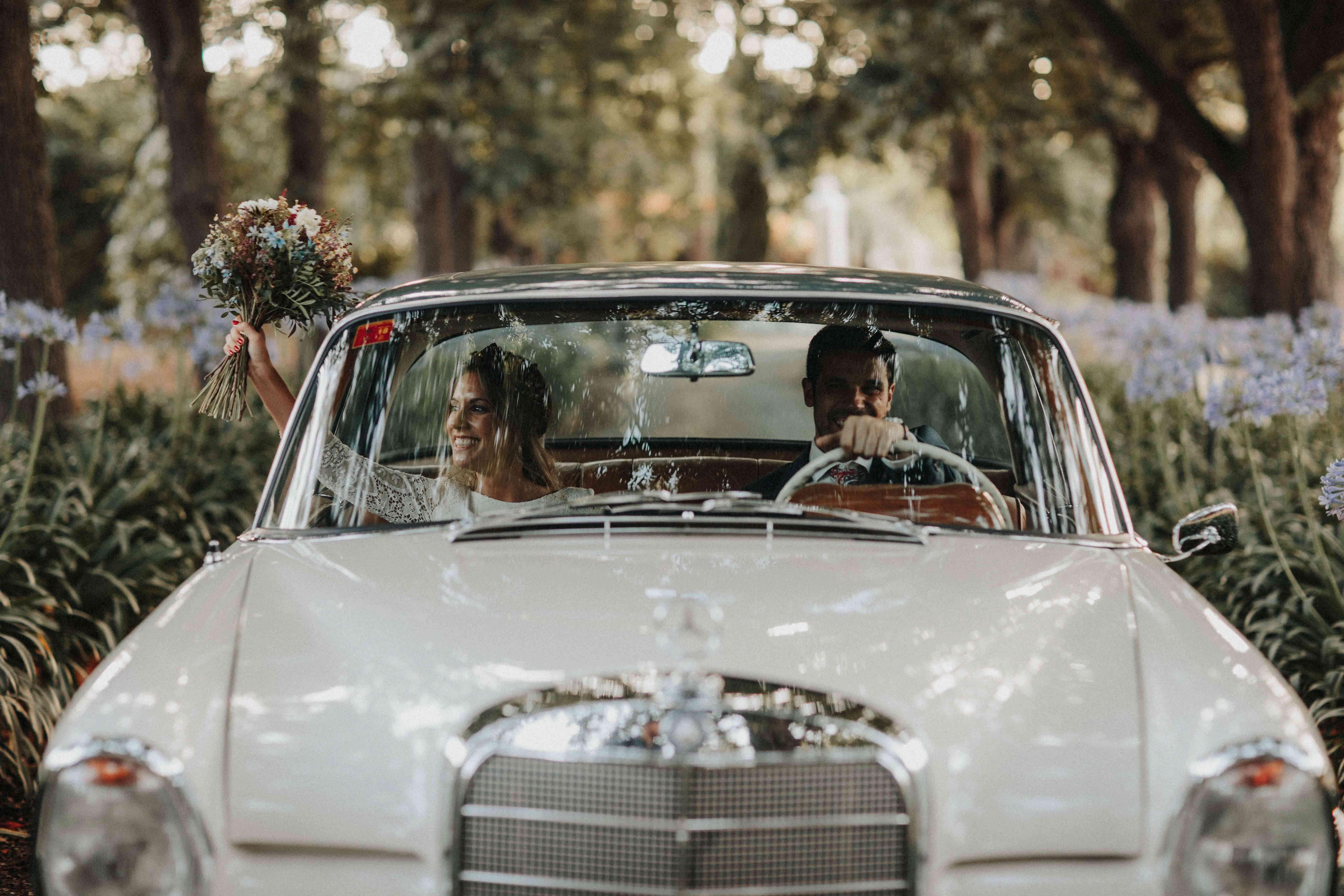 <p>Bride and groom in getaway car</p><br><br>
