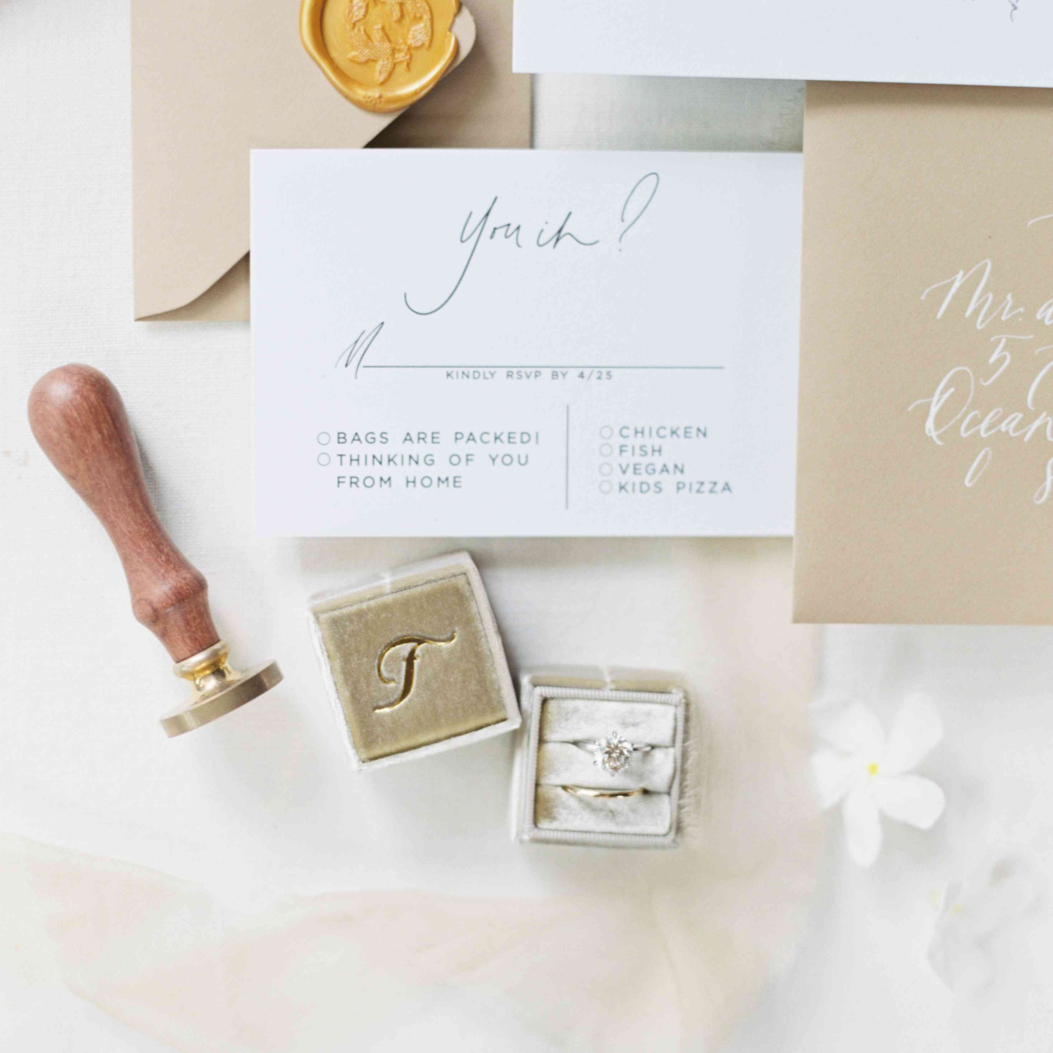 RSVP card and rings flat lay