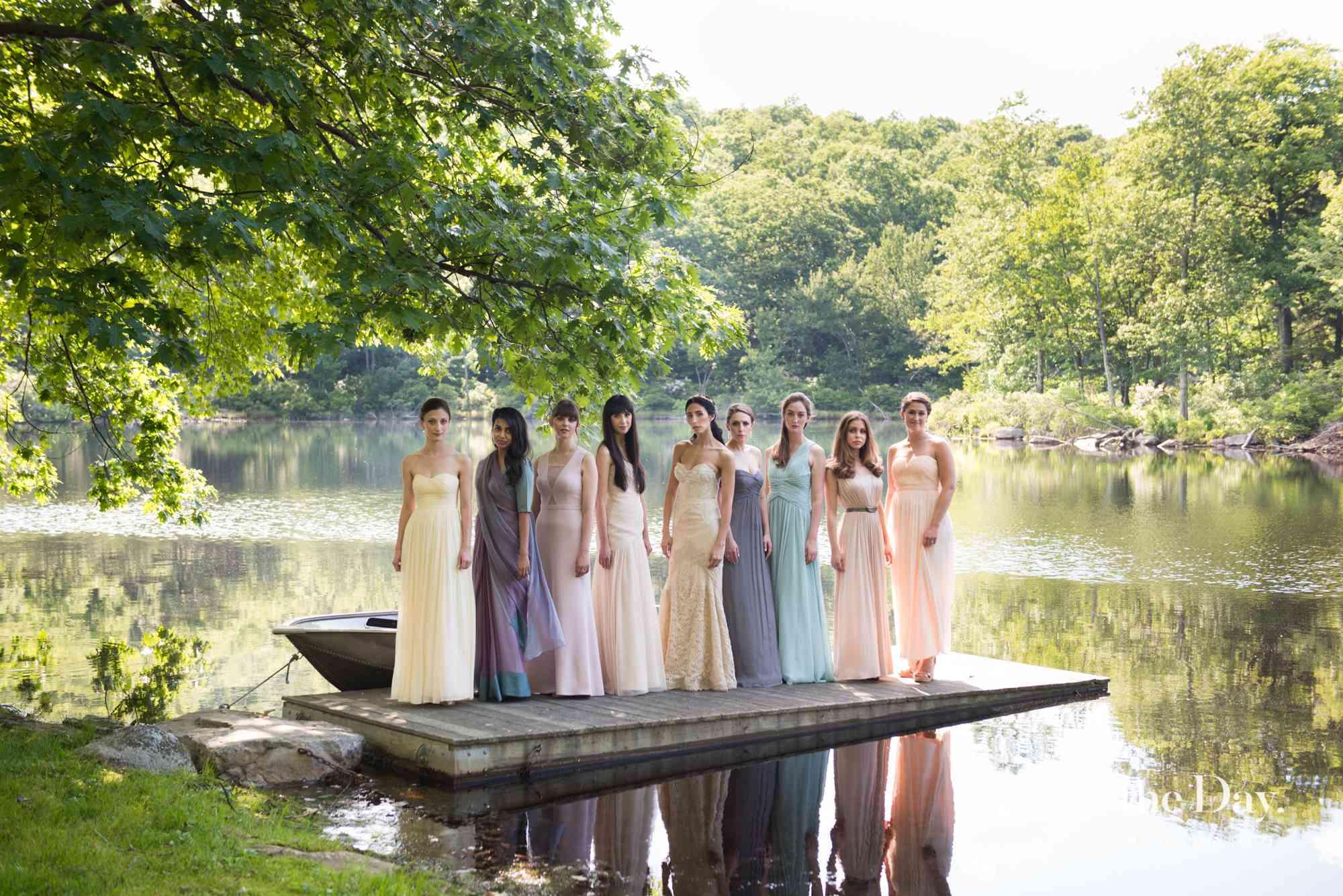 <p>A bridal party on the bridge of a lake.</p>
