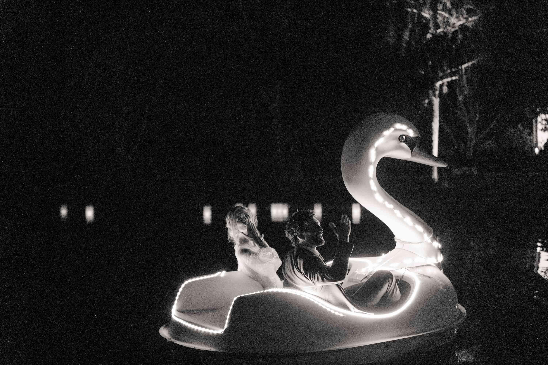 bride and groom in swan boat
