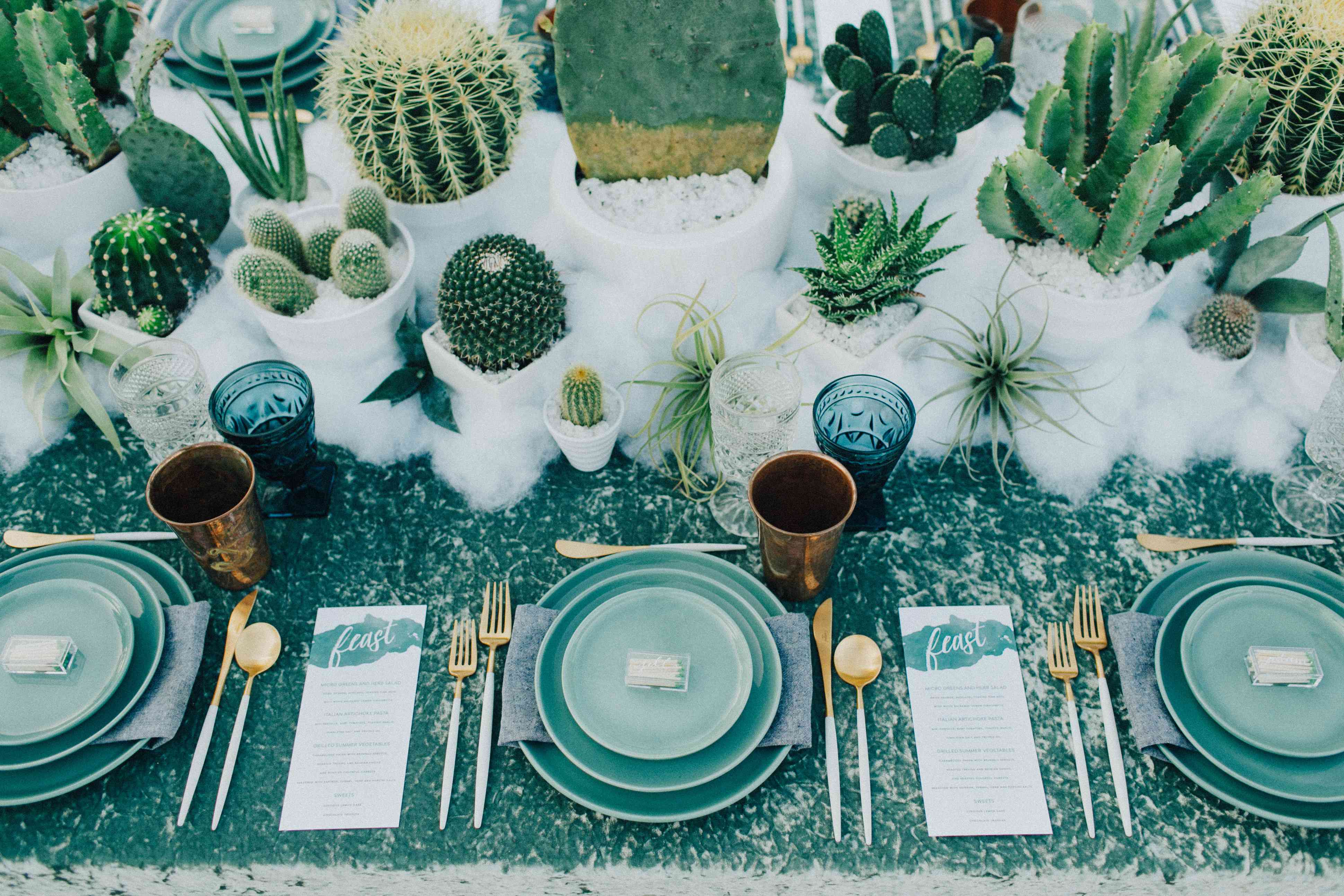 Teal tablescape with gold accents