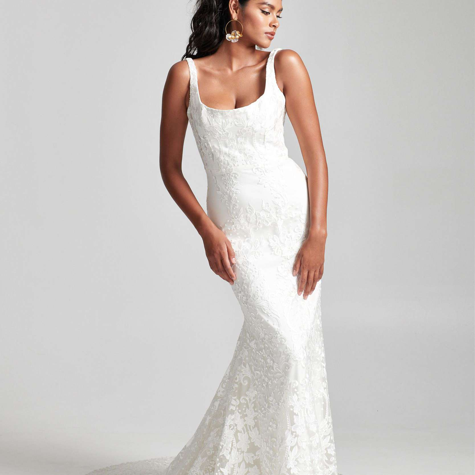 Model in sleeveless lace wedding dress with scoop neckline