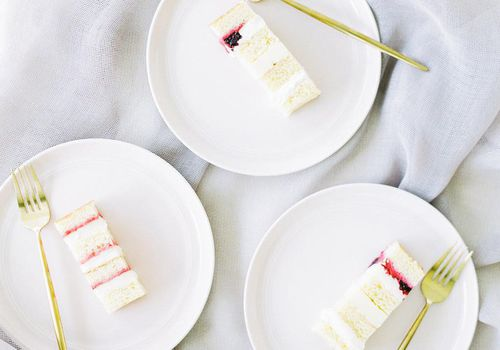 Slices of white cake with white buttercream
