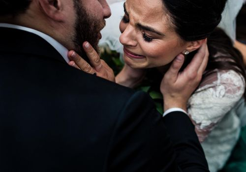 Emotional bride and groom
