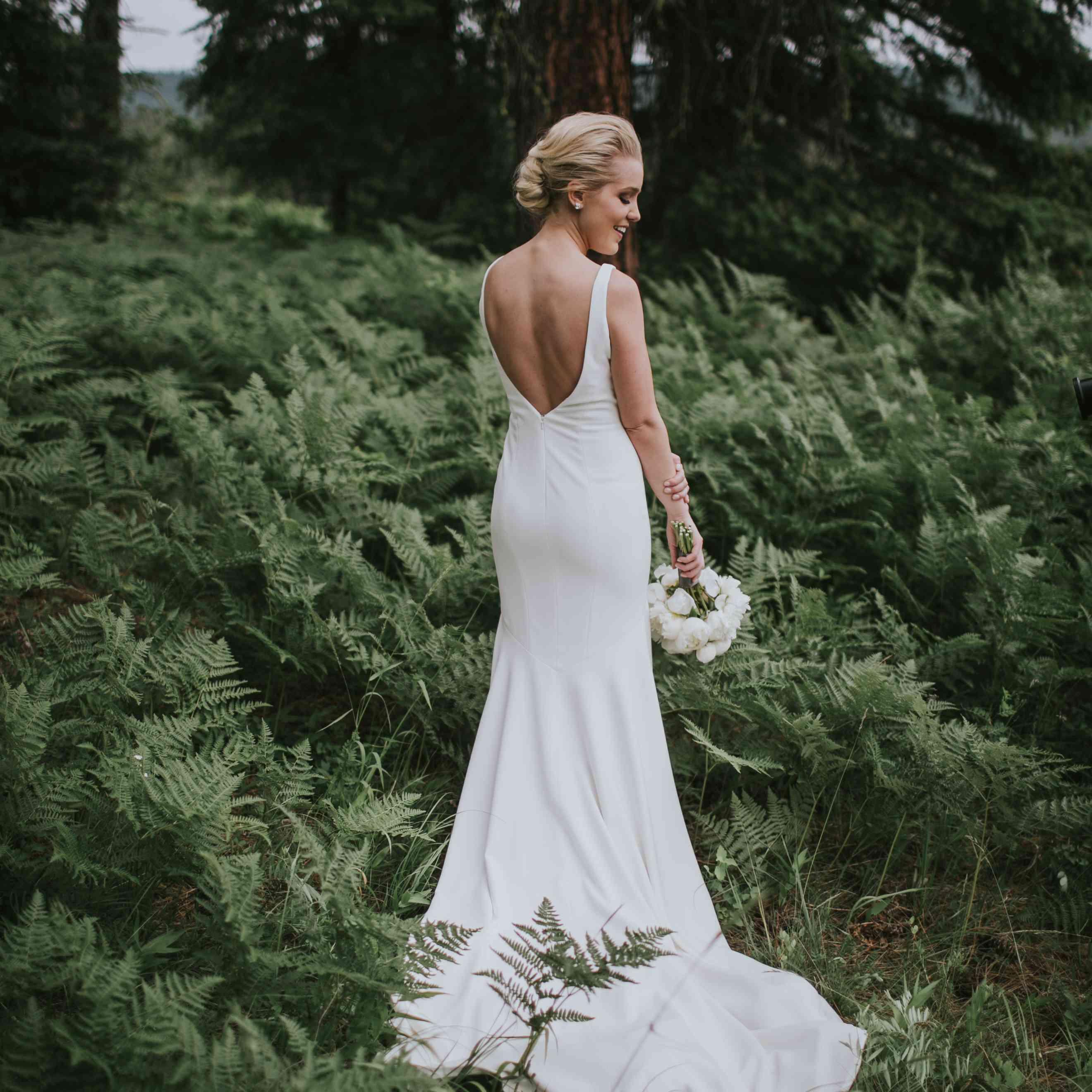 Bride wearing open back dress