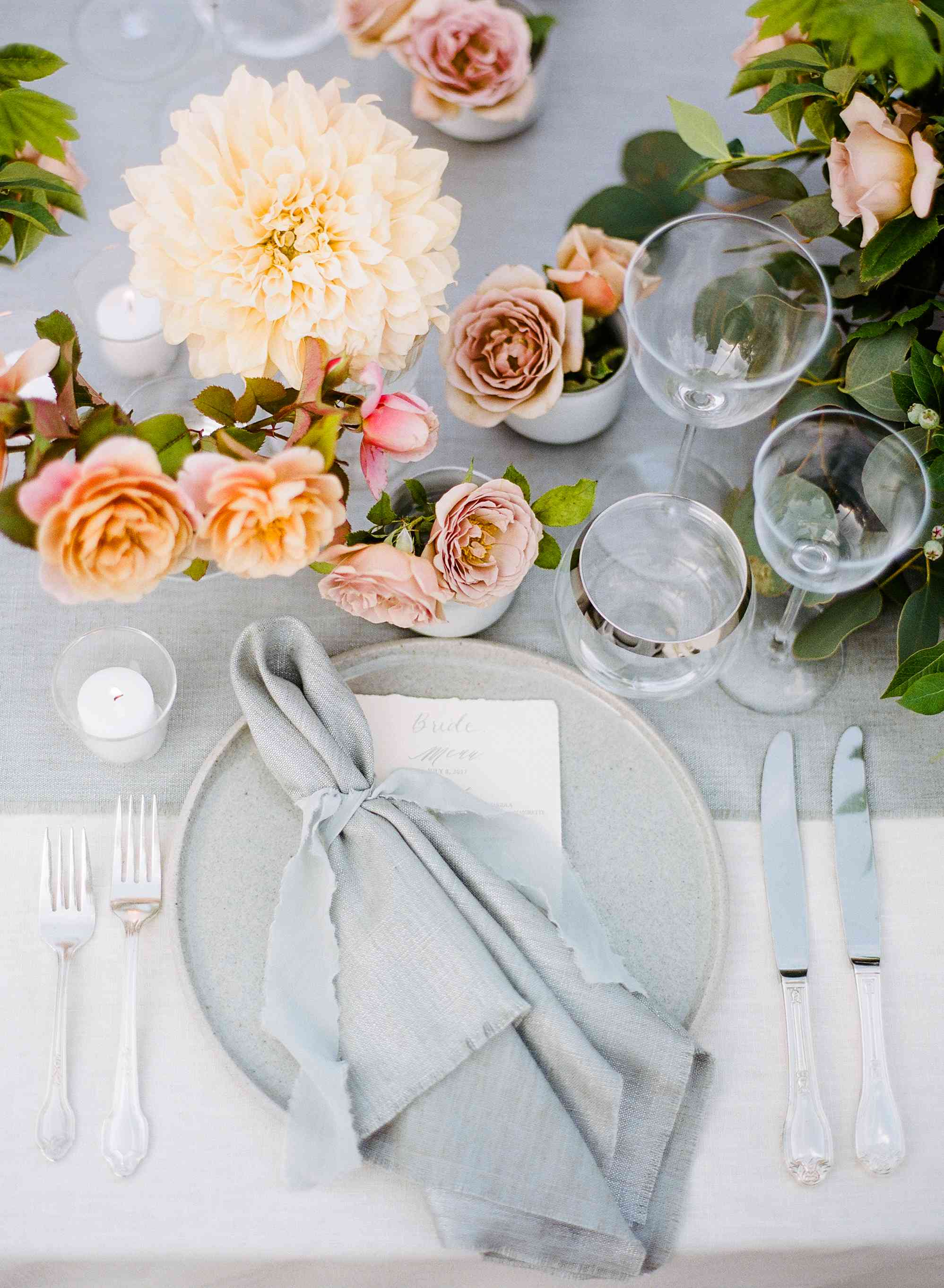 Table setting with gray napkin and plate with pastel flower decor
