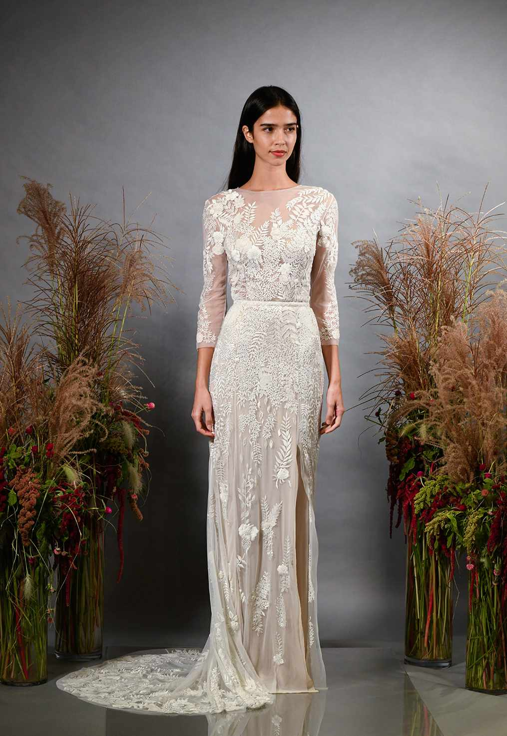 Model in sheer embroidered wedding dress