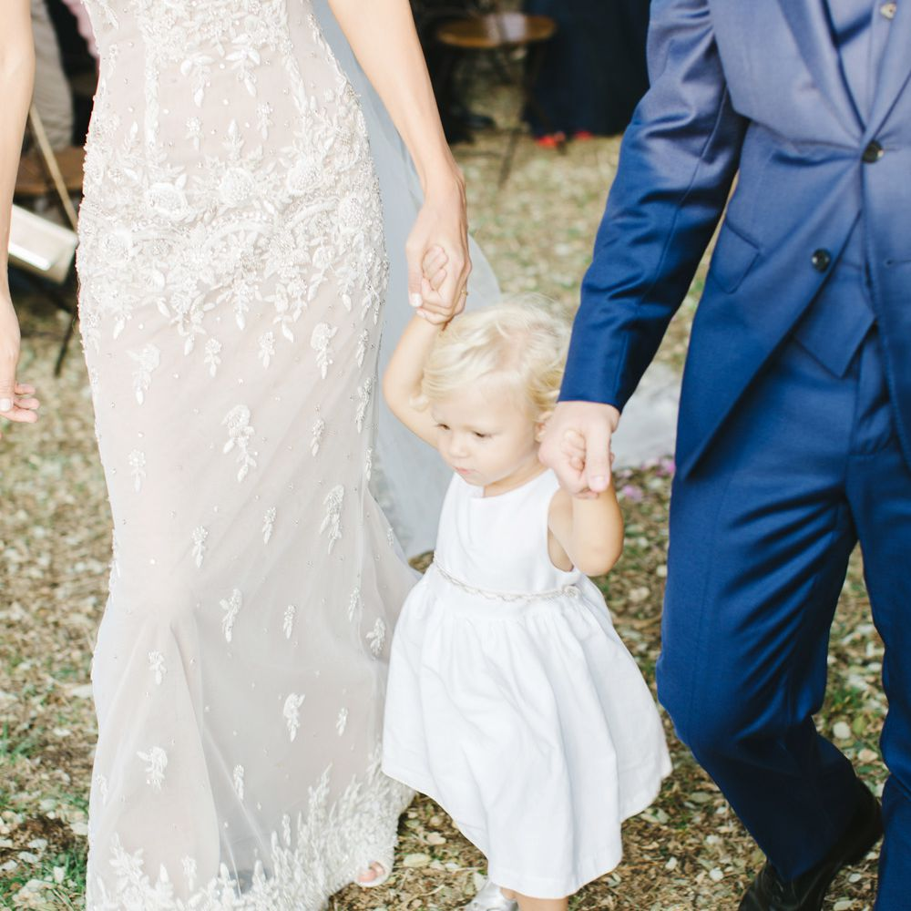 bride and groom with daughter