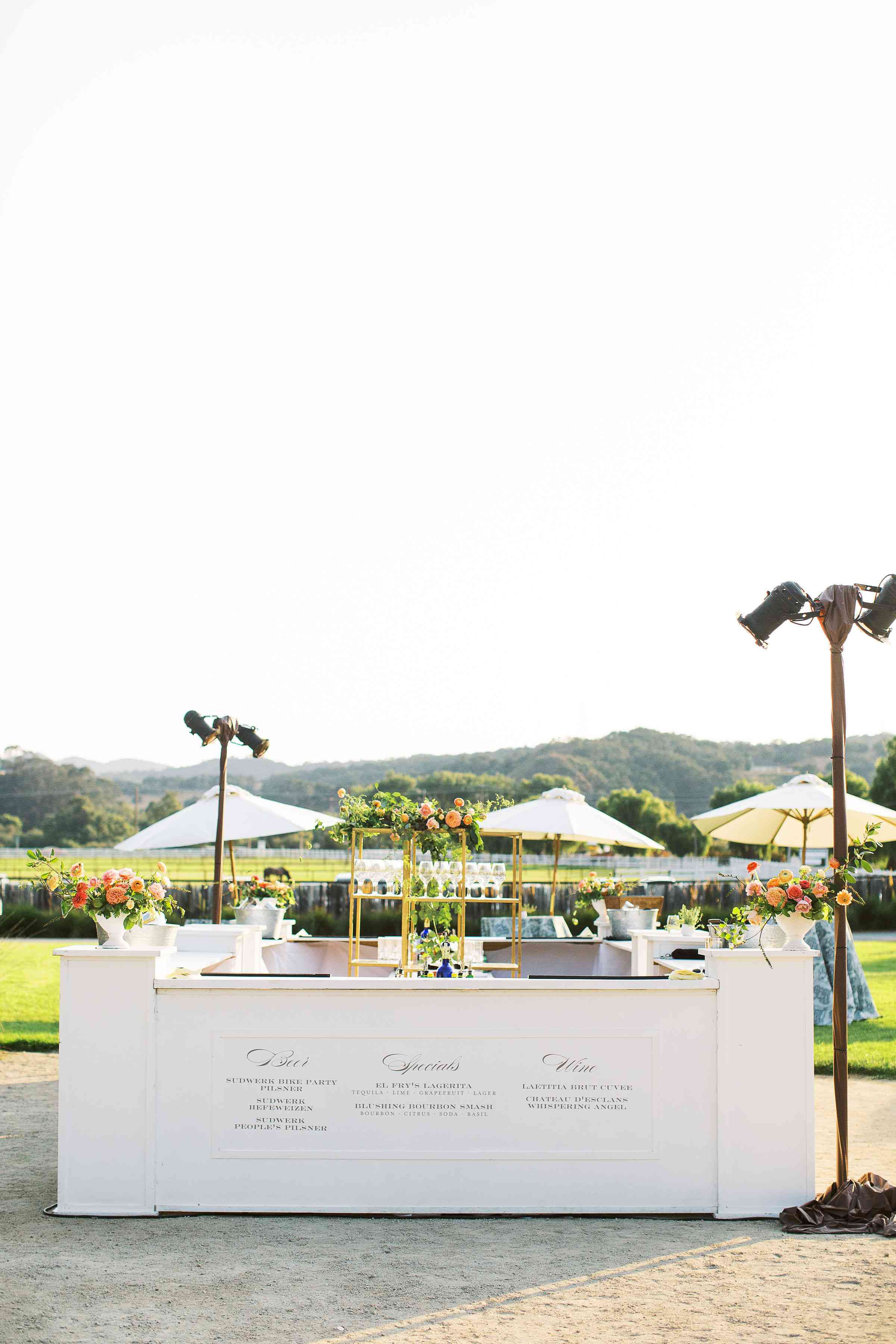 Double-sided outdoor bar at a wedding reception