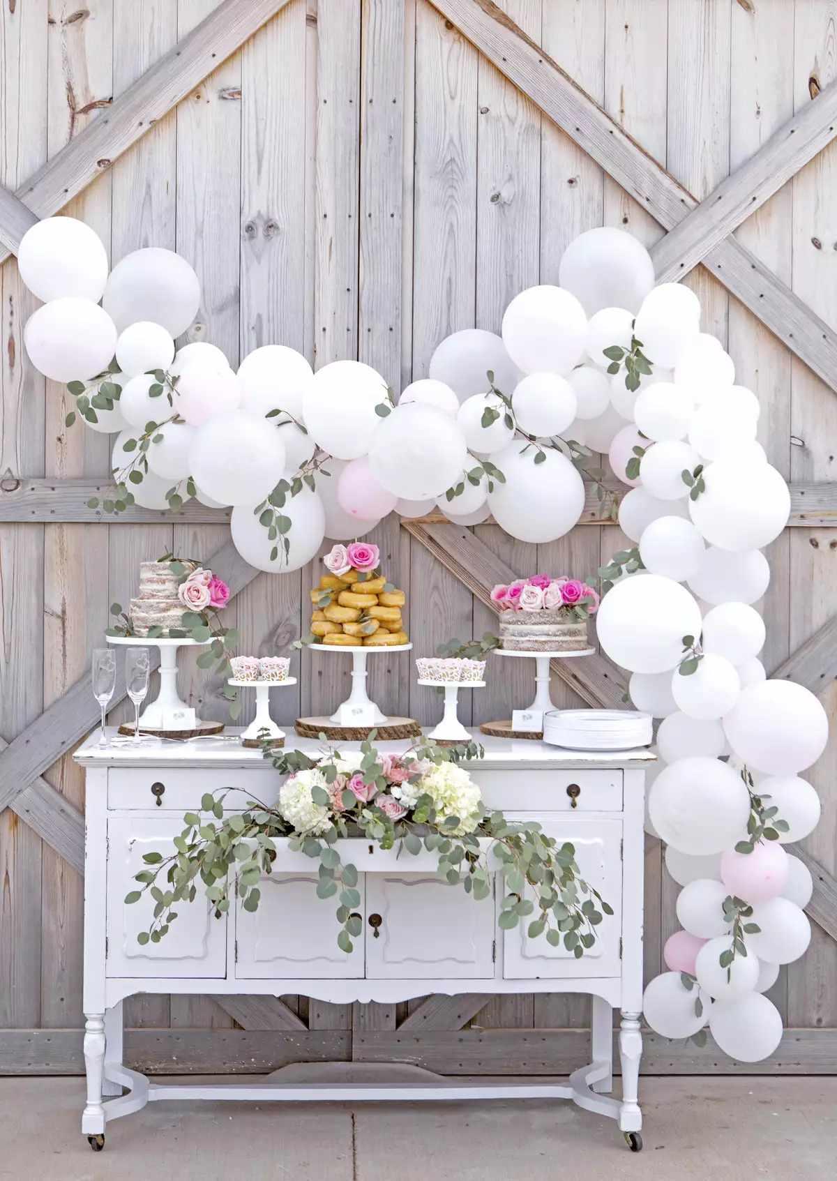 White balloons over the dessert table