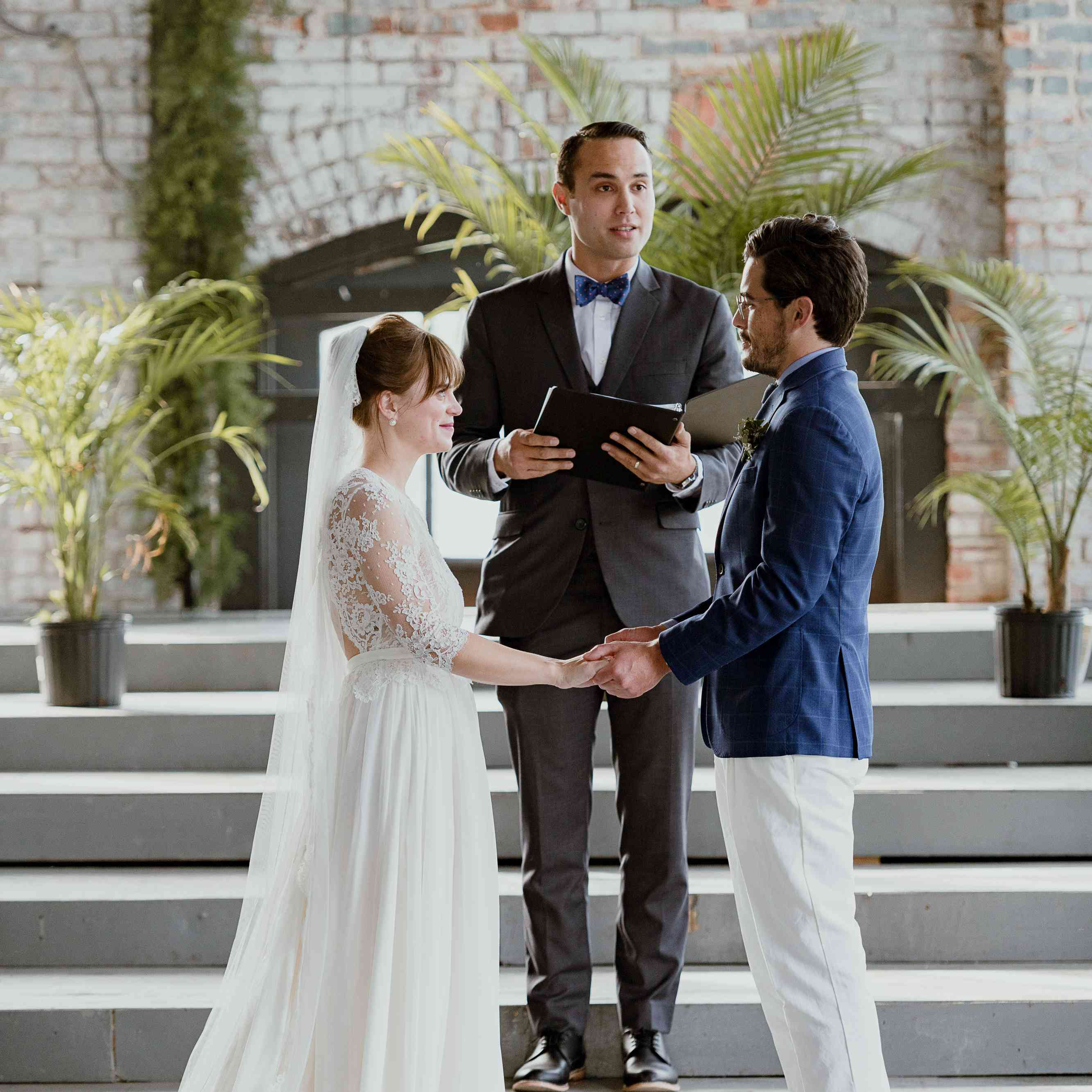 <p>ceremony couple at altar</p><br><br>