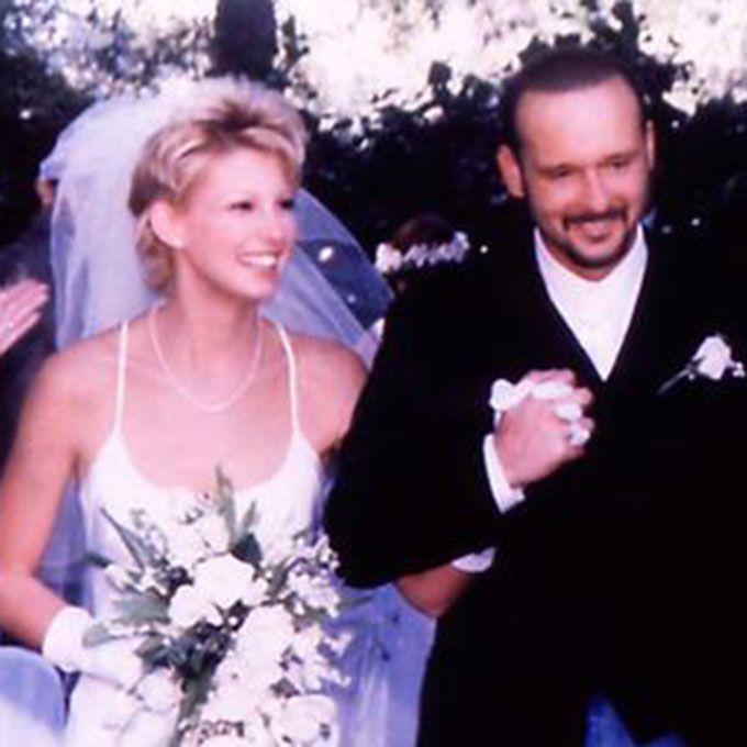 Faith Hill marries Tim McGraw in a white sheath gown, 1996