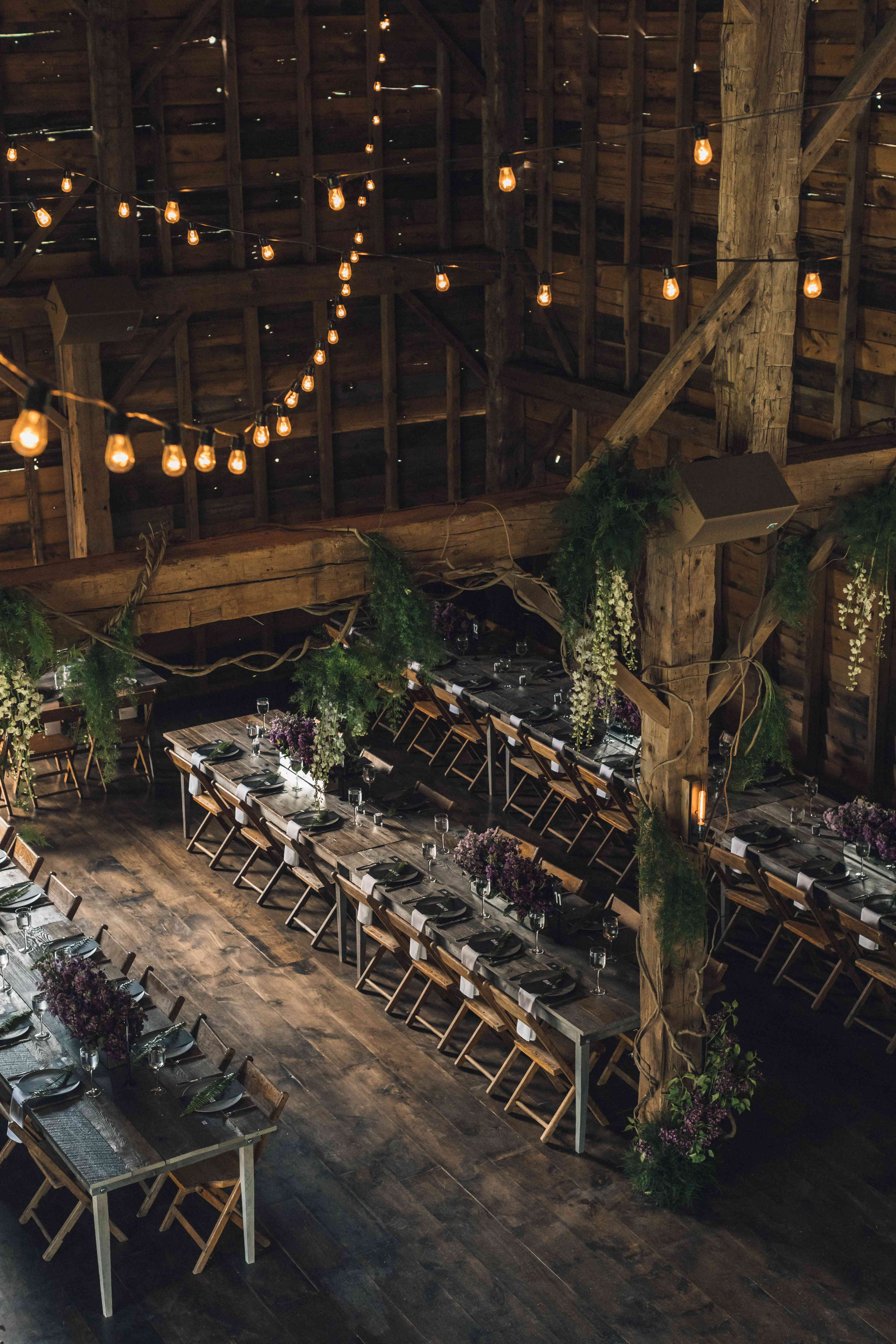 <p>Reception table setting in barn</p>