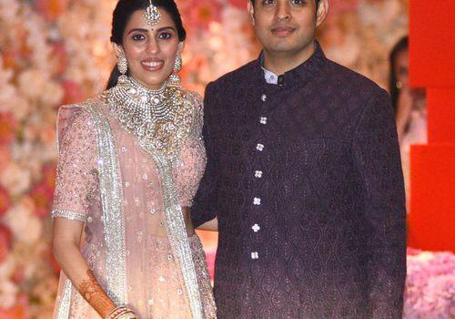Akash Ambani and Shloka Mehta pose at their pre-engagement party in Mumbai.