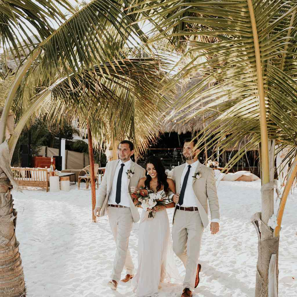 A bridesmaid and groomsmen process up the aisle.