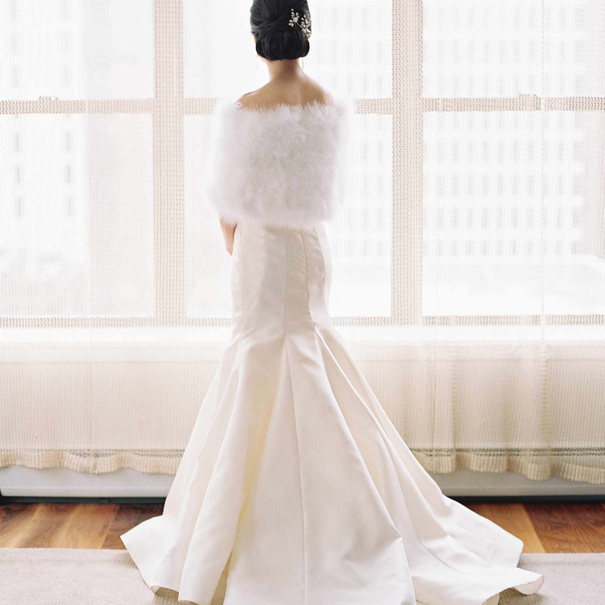 back of wedding dress and faux fur wrap