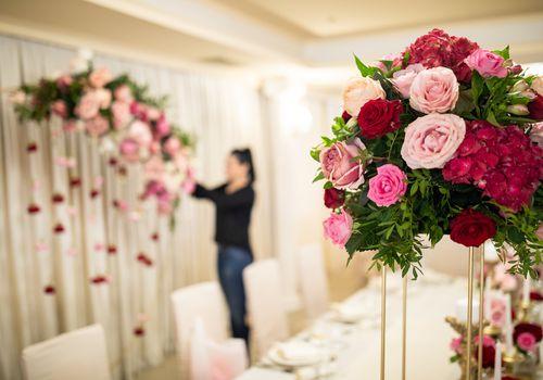Florist decorating for a wedding reception