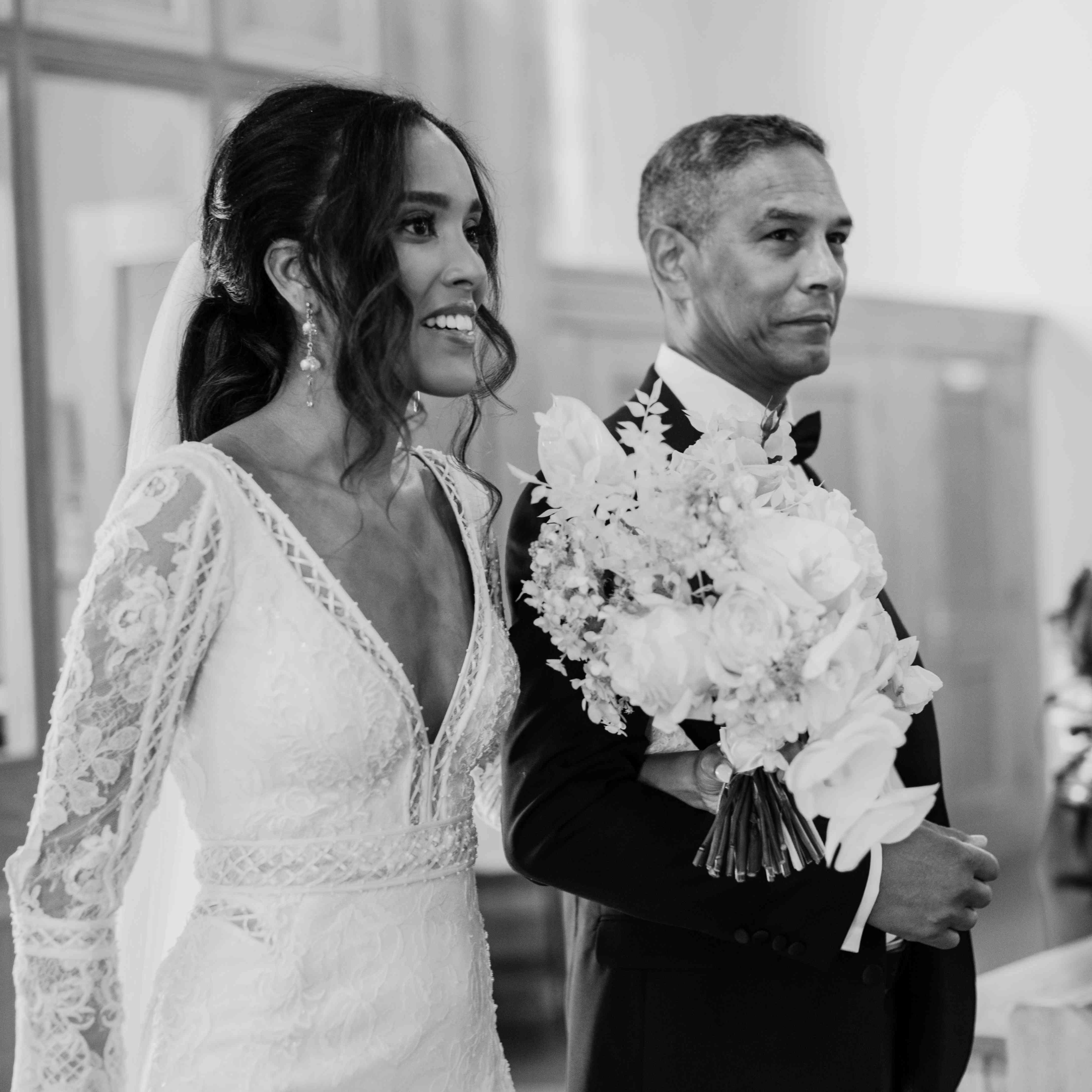The bride walks down aisel with her father