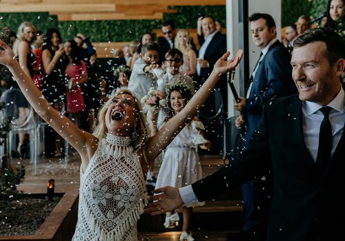 Bride throwing rice in the air