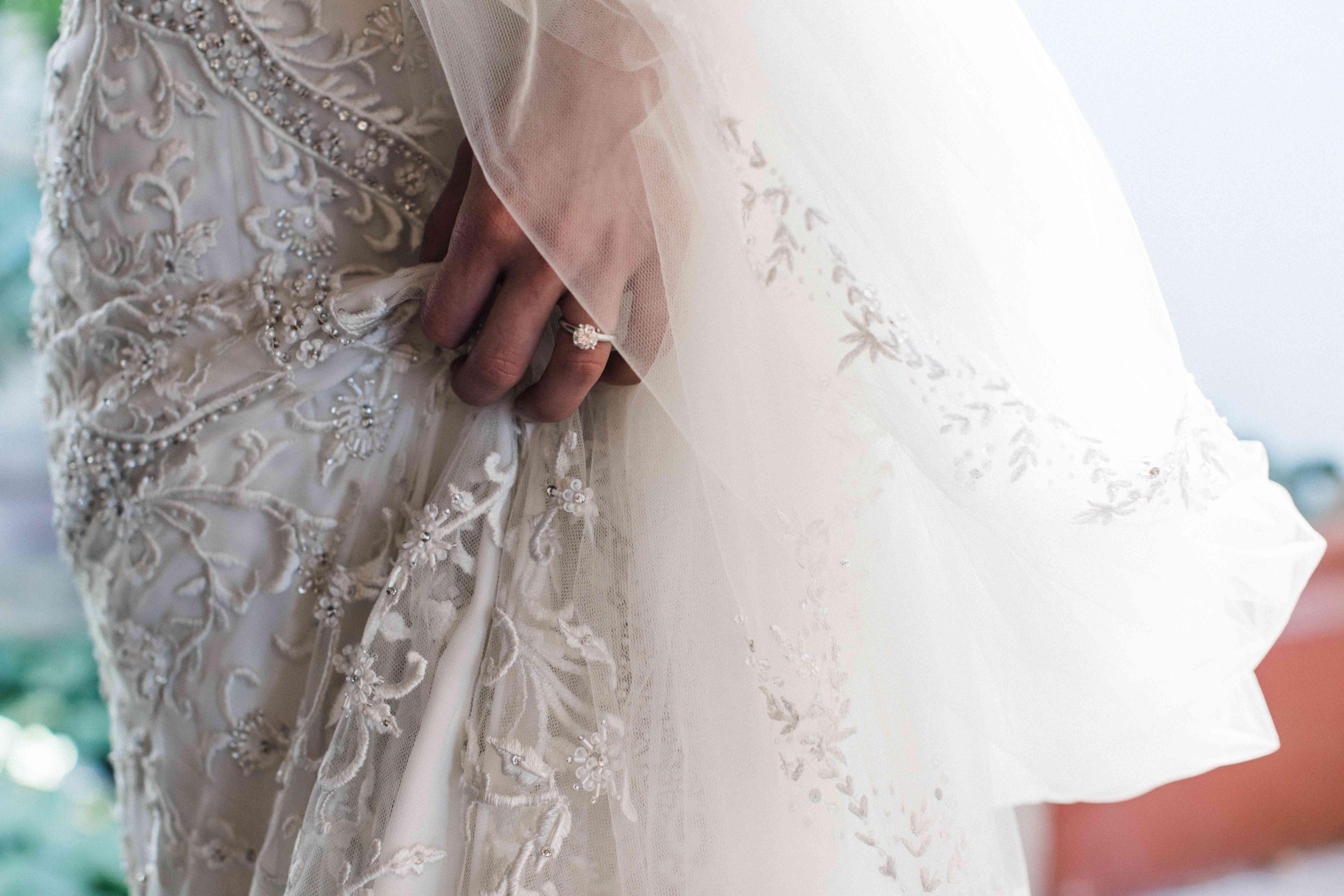 <p>wedding dress detail shot engagement ring</p><br><br>