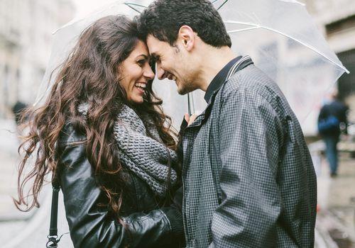 Romantic Couple Under Umbrella