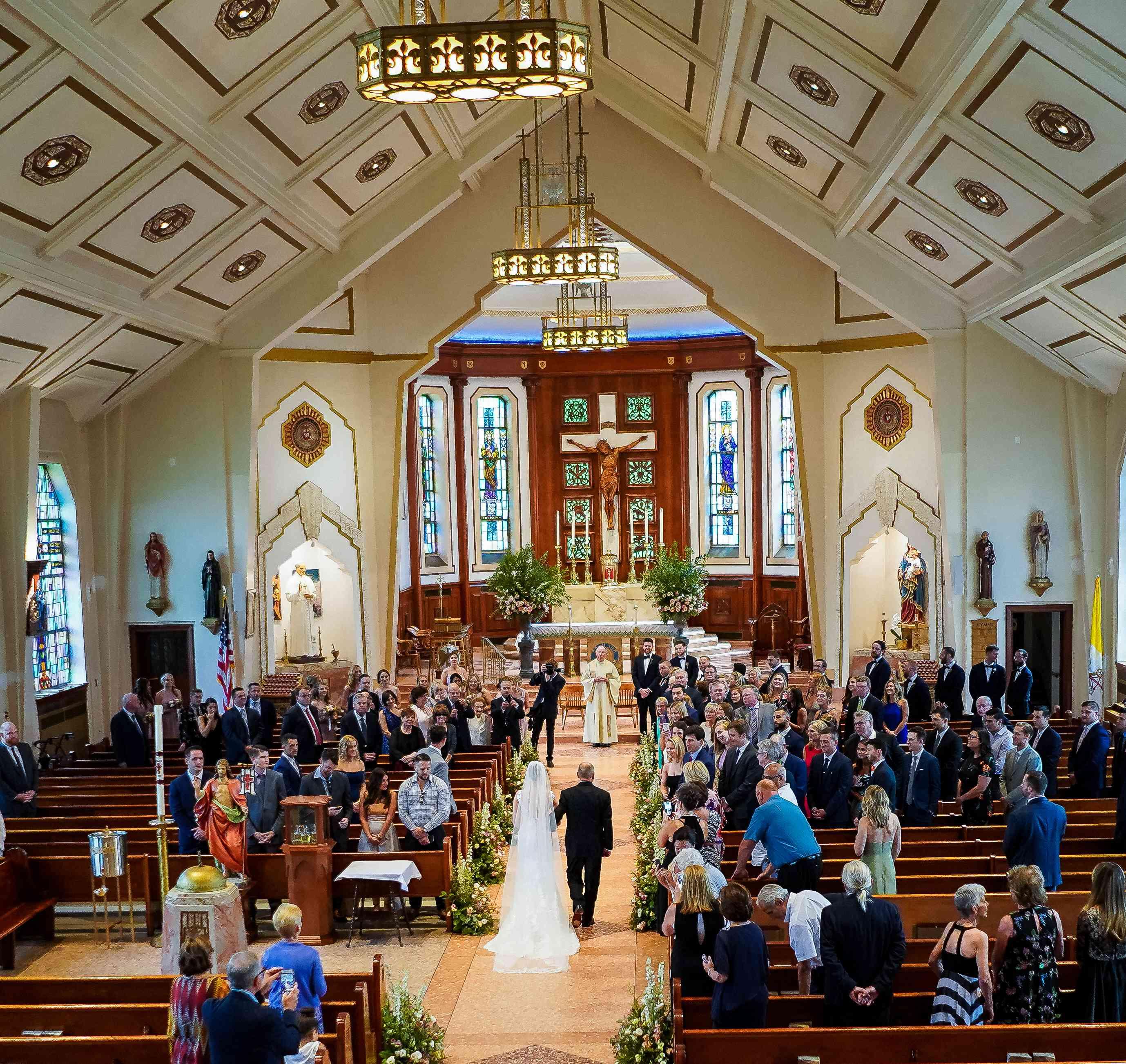 <p>church ceremony bride walking down aisle</p><br><br>