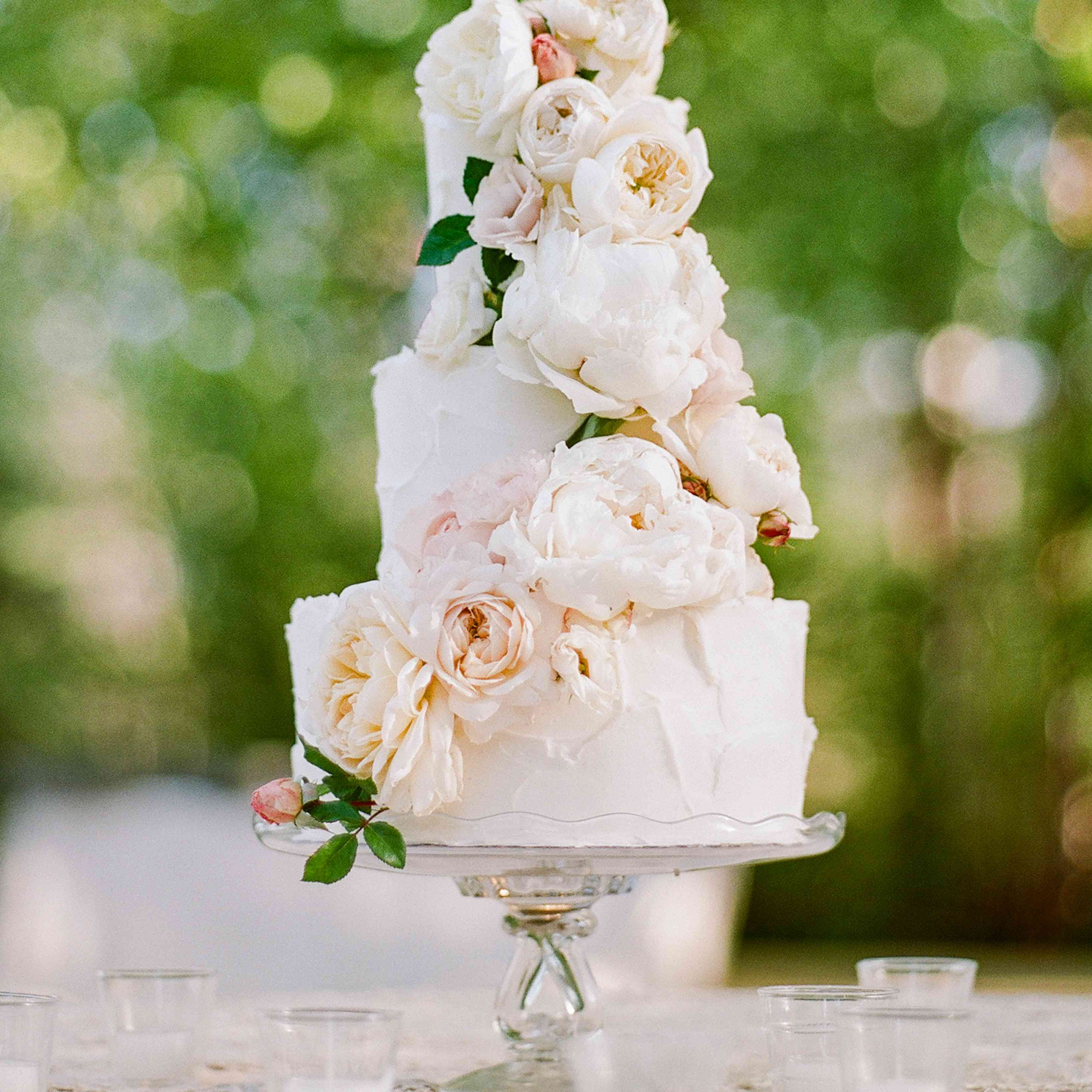 A white wedding cake with fresh flowers