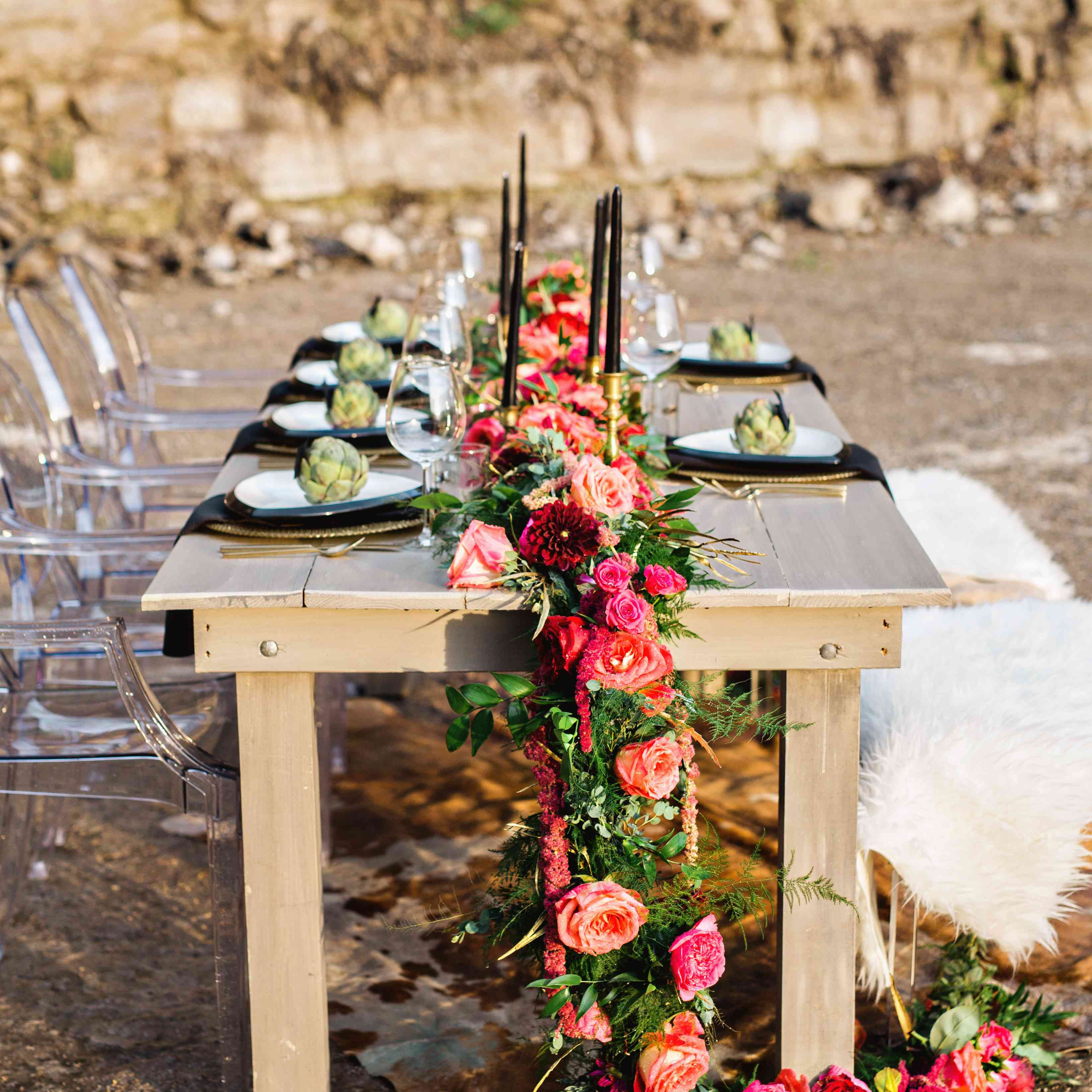 Garland of pink and red roses with black table accents