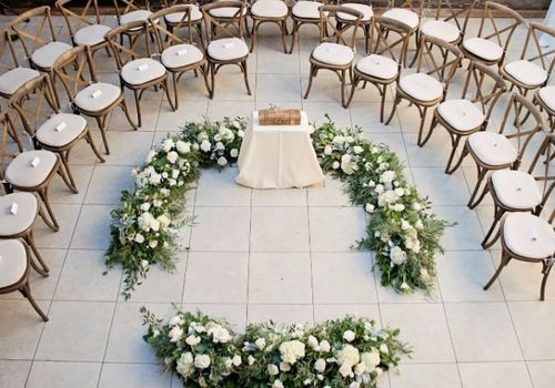 Wedding seats arranged in a circle around an alter in the center