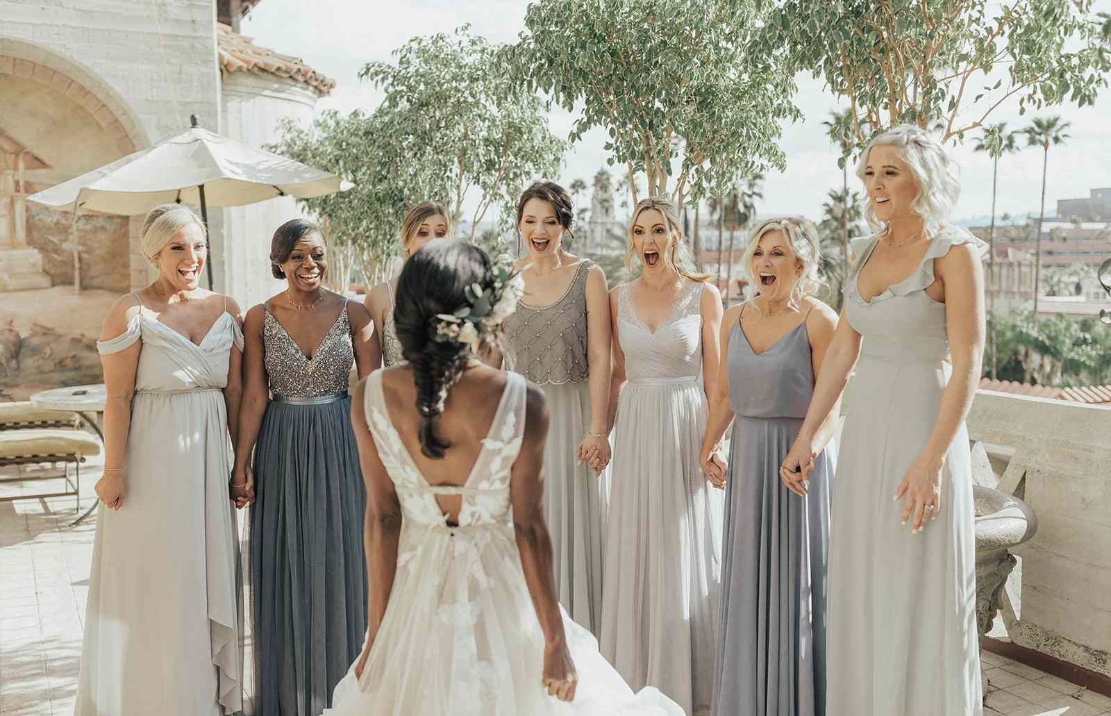 bride and bridesmaids first look