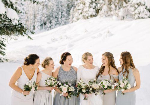 <p>bridesmaids in mismatched grey dresses</p>