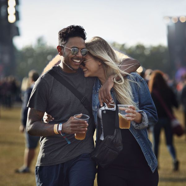 couple holding beers