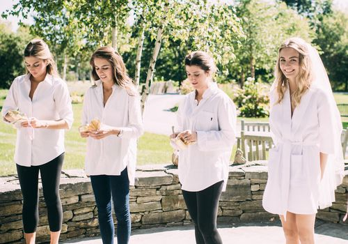 <p>bridesmaids opening their bridesmaids gifts</p>