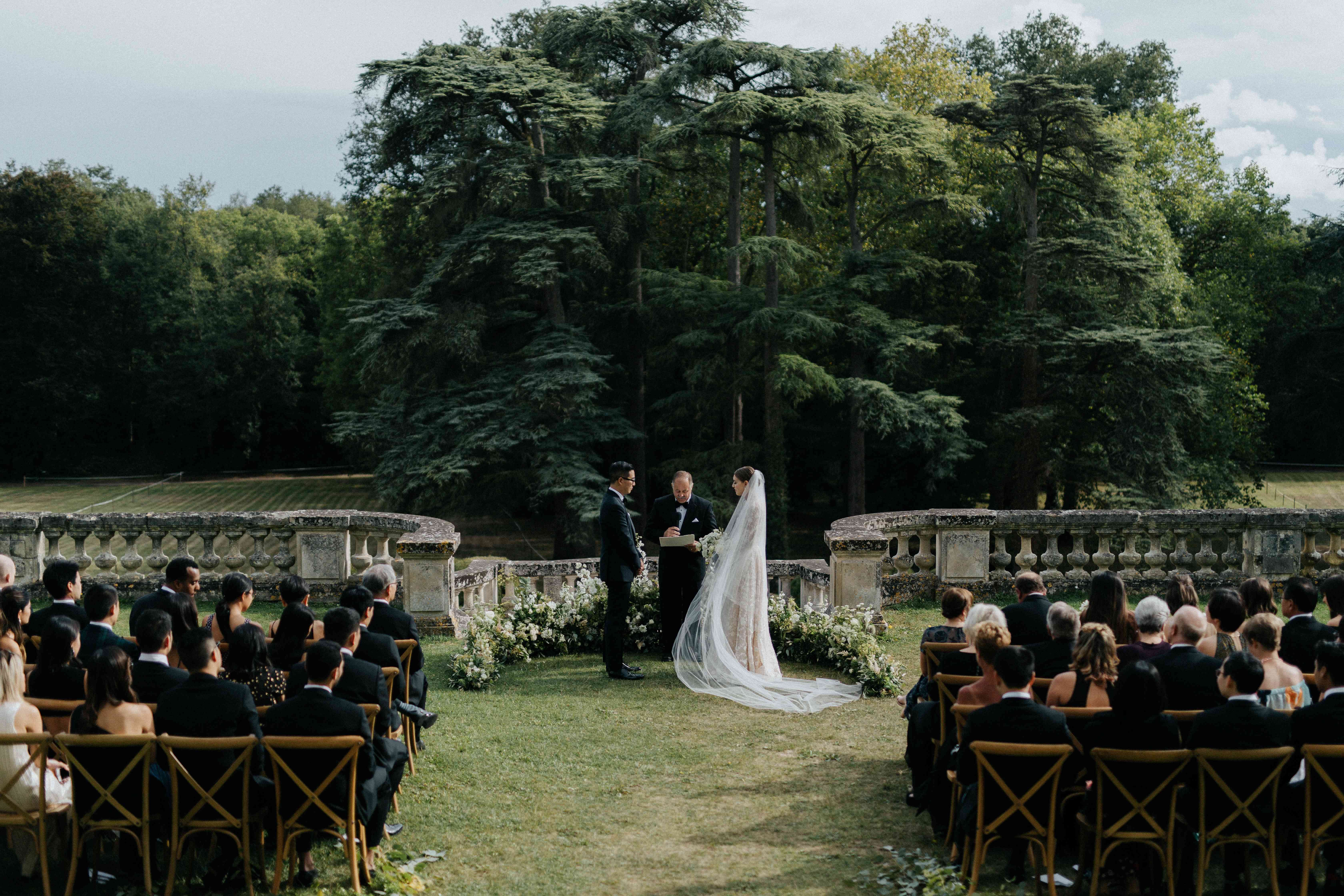 <p>couple at altar outdoor wedding</p><br><br>