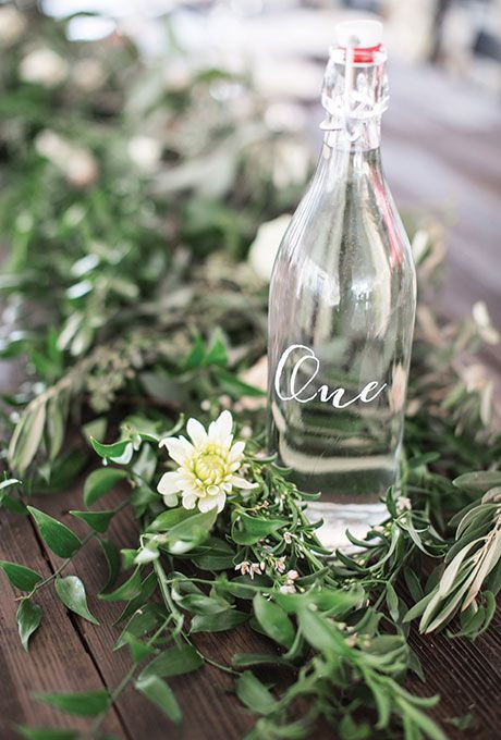 Clear glass bottle painted as a table number