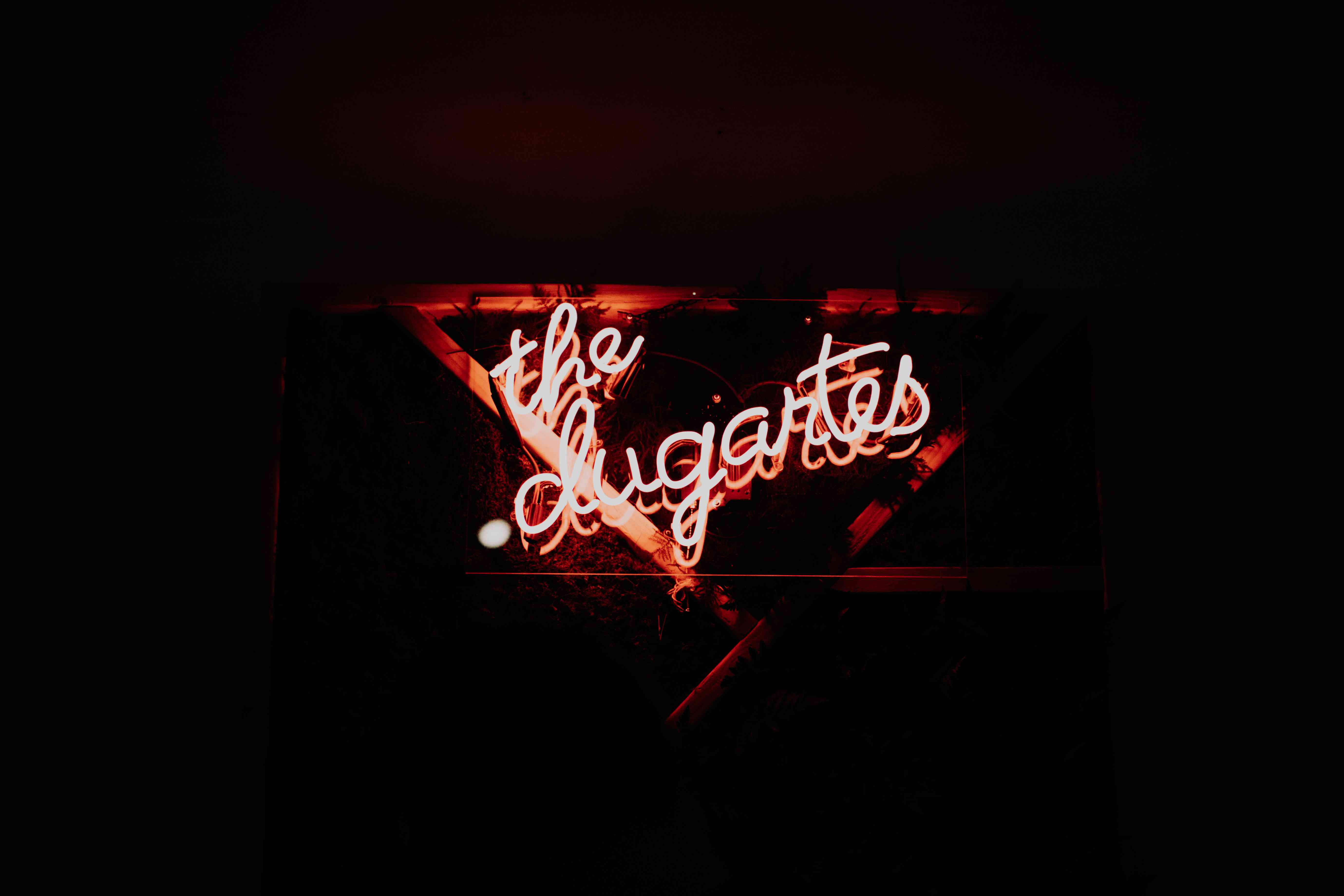 Script neon sign with geometric frame