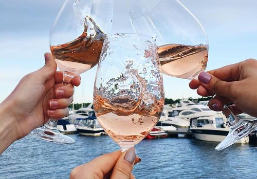 Rose glasses with boats in background