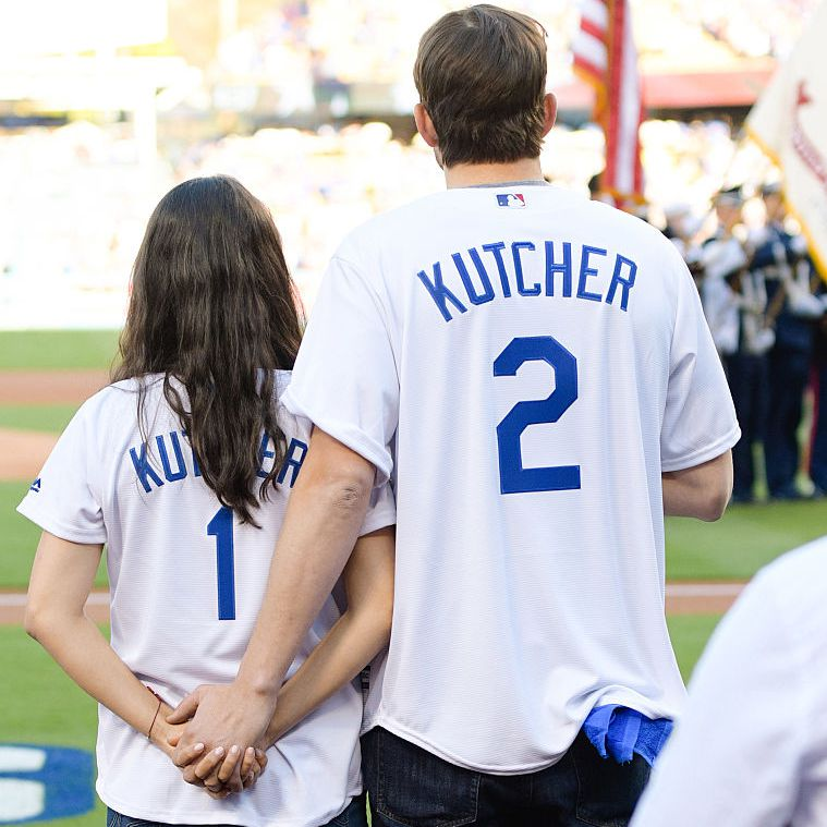 Mila Kunis and Ashton Kutcher attend game 4 of the NLCS between the Chicago Cubs and the Los Angeles Dodgers at Dodger Stadium on October 19, 2016 in Los Angeles, California.