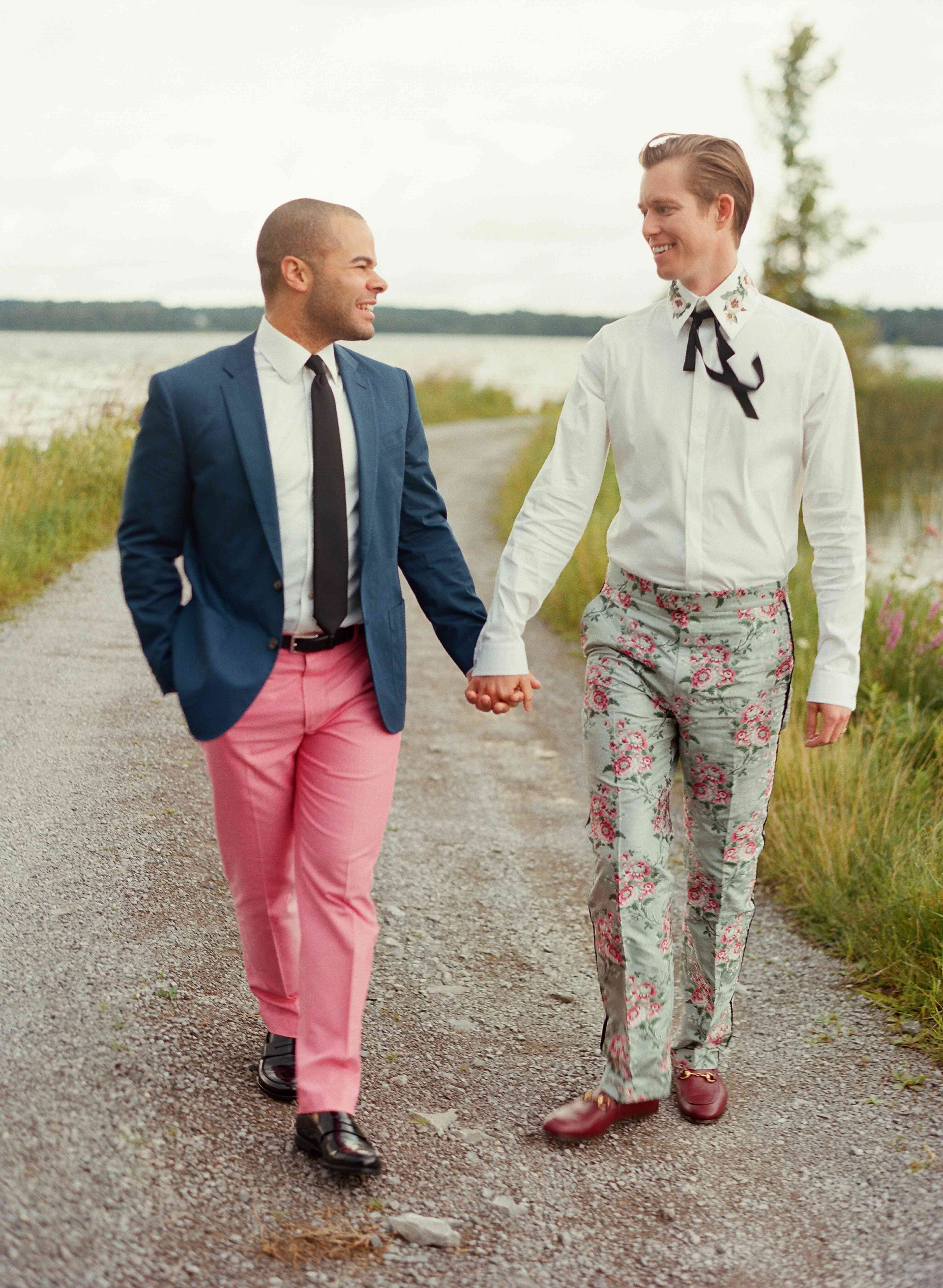 Grooms holding hands