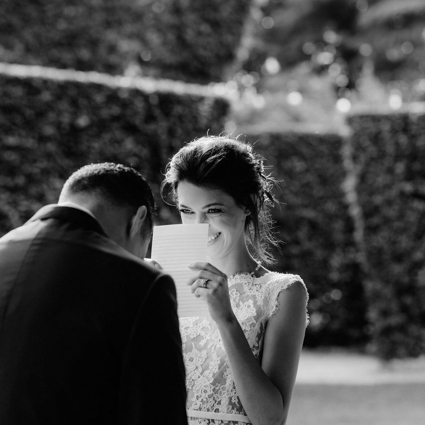 bride reading love note from groom