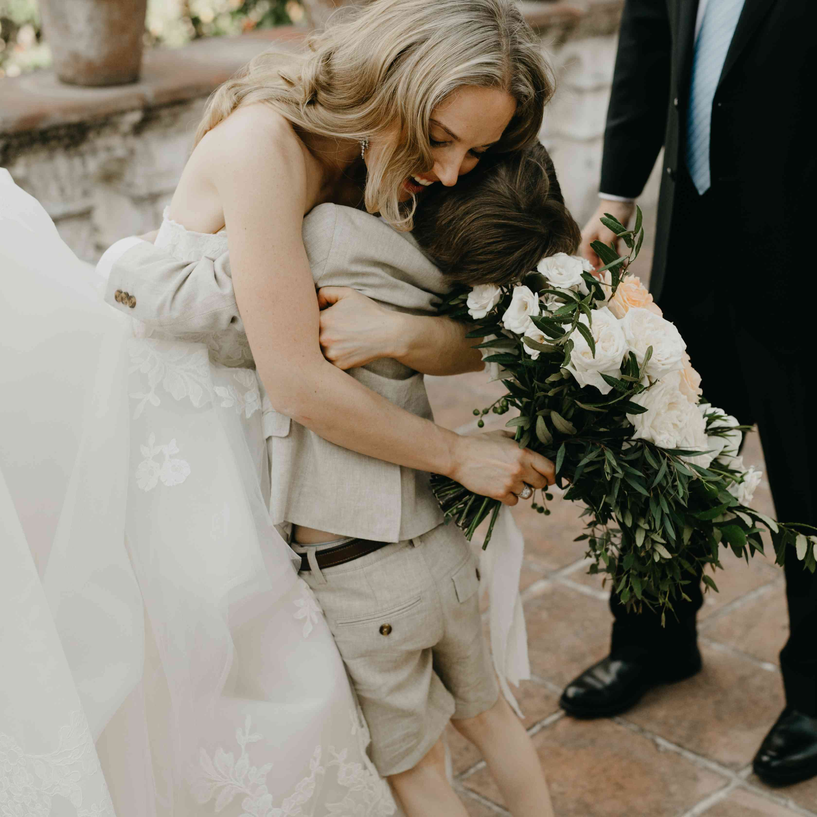 bride hugging ring bearer