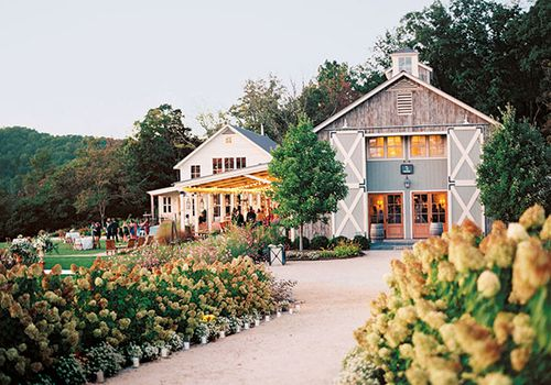 Rustic barn amid floral landscaping