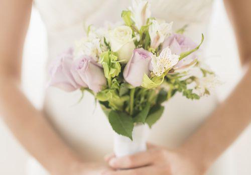 <p>Bride holding a bouquet</p>