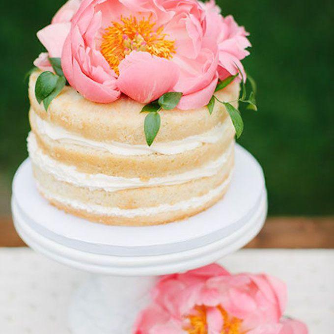 Naked cake with big pink peony on top