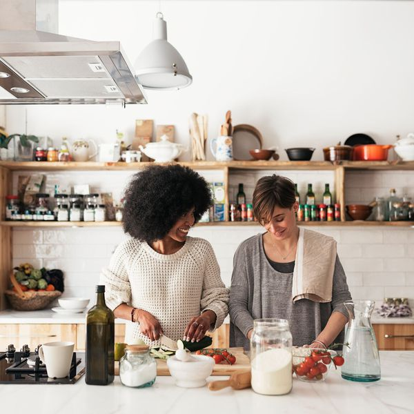 female couple cooking in kitchen