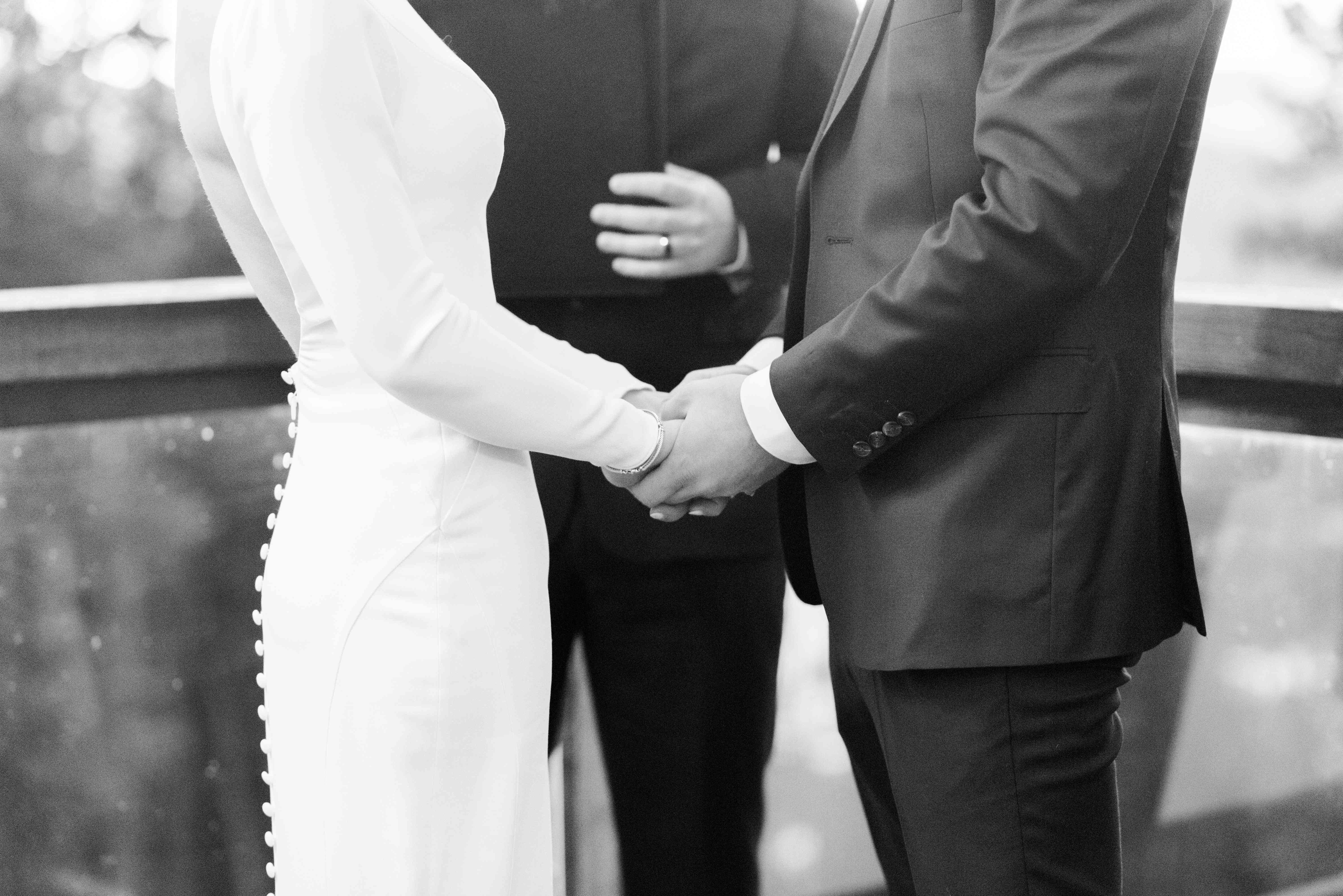 bride and groom holding hands ceremony