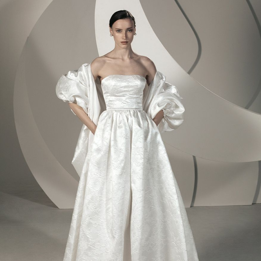 white gown and cape
