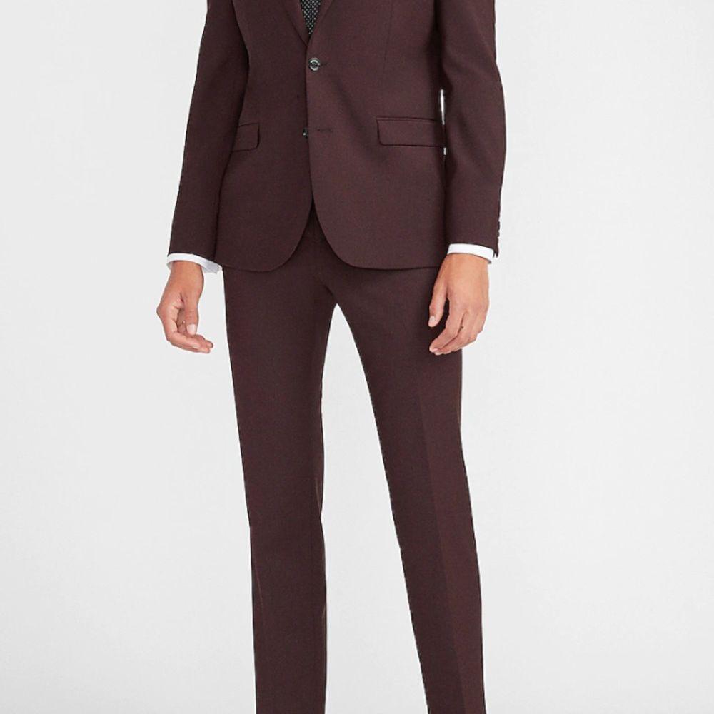 burgundy suit black tie