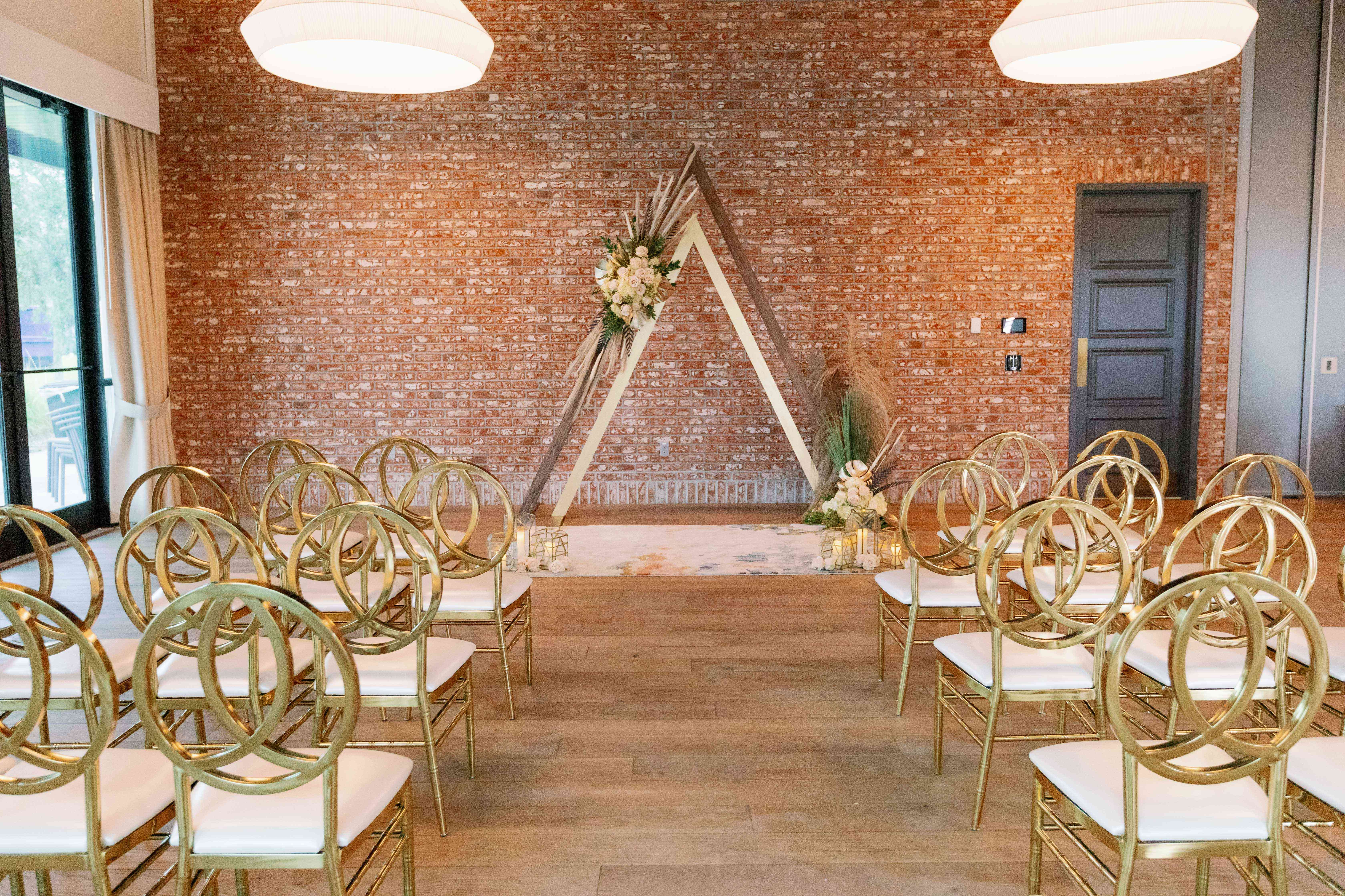 Ceremony space with exposed brick wall at Dockside Lake Nona wedding venue