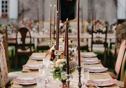 Burgundy candles on tablescape